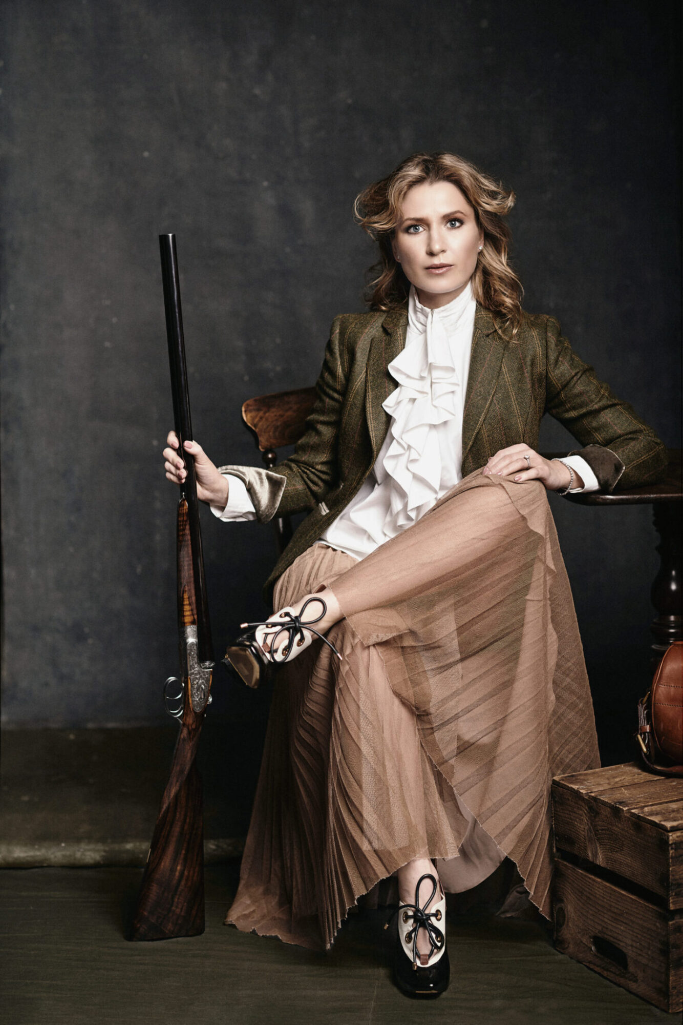 Gun: HOLLAND & HOLLAND, 'ROYAL DELUXE' SIDE-BY-SIDE SHOTGUN, Photo: GABOR SZANTAI, Model: ANASTASSIA VORONTCOVA, Makeup: TATIANA DOROGAYA, Hair: JENYA GRIBOV, Style: SHERRY WALKER