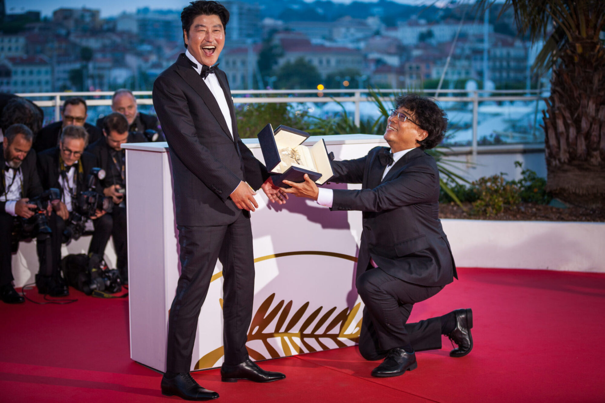 "Director Bong Joon-Ho with Kang-Ho Song, winner of the Palme d'Or award for his film ""Parasite"" poses at the photocall for Palme D'Or Winner - 72 Cannes Film Festival"