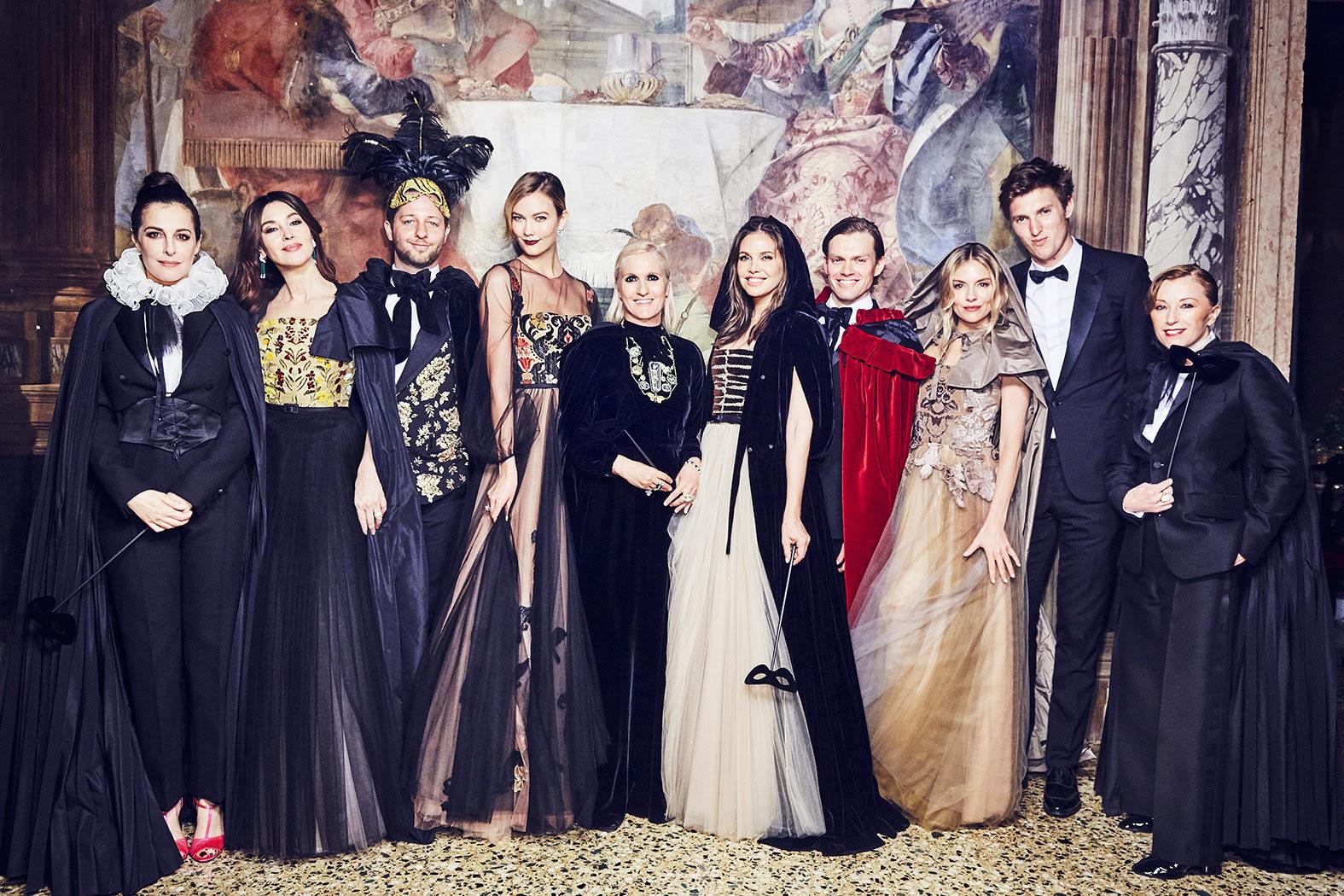 Maria Grazia Chiuri, centre, with guests including Sienna Miller, Karlie Kloss,Monica Bellucci and Dasha Zhukova - Photo: Ellen Von Unwerth